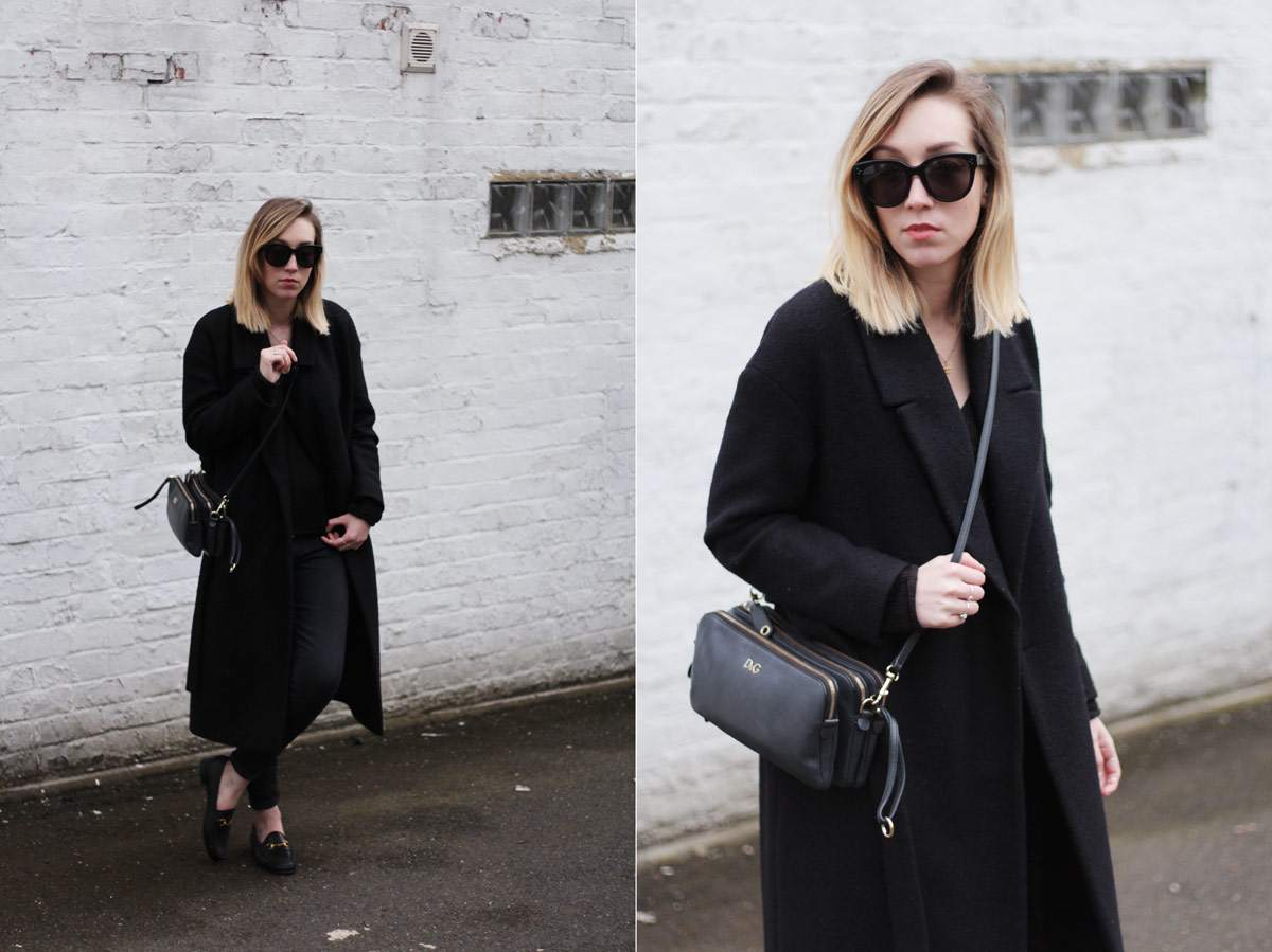 staple-all-black-look-gucci-loafers-cos-belted-coat-d&g-bag