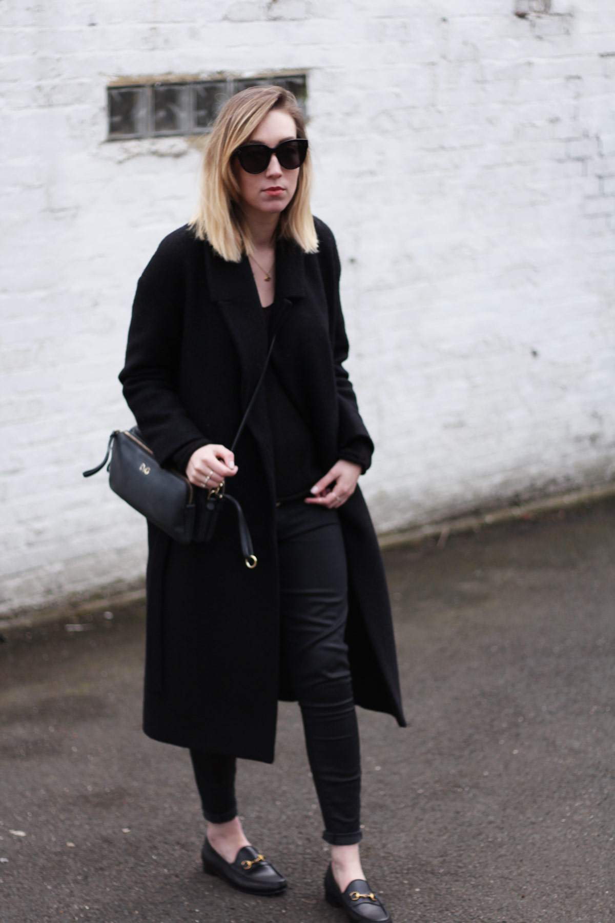 staple-all-black-look-gucci-loafers-cos-belted-coat-d&g-bag-3