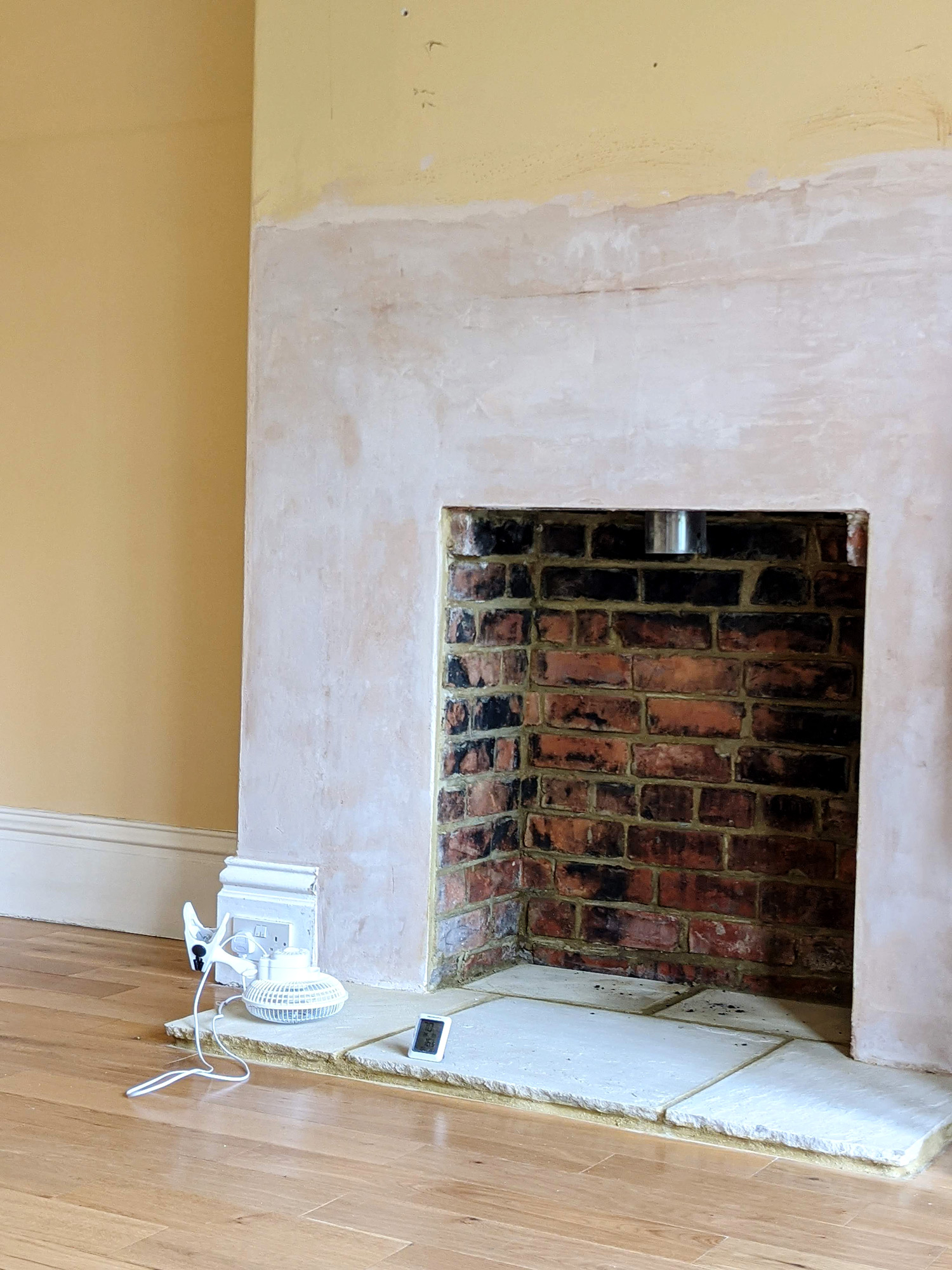 thelovecatsinc-installing-log-buring-stove-fire-3