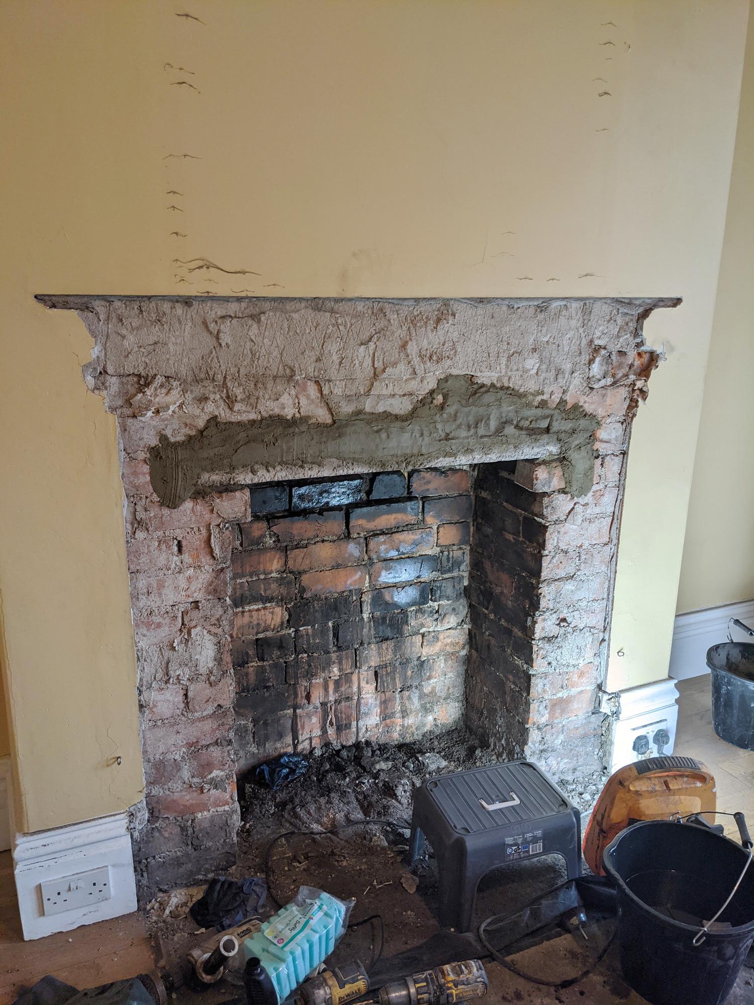 thelovecatsinc-installing-log-buring-stove-fire